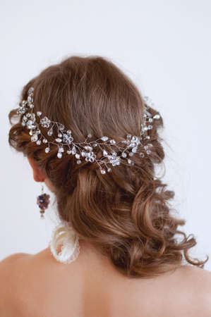 headpiece: Bridal hairstyle with beaded crystal headpiece on long wavy brown hair
