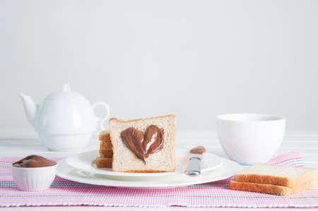 Sunday breakfast. Croissants with tea, toast and peanut butter.