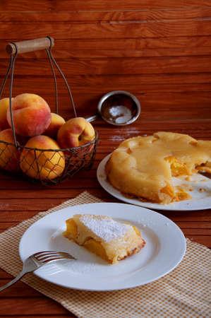 Peach caramel turnover pie sprinkled with sugar powder. Delicious summer dessert. Stock Photo