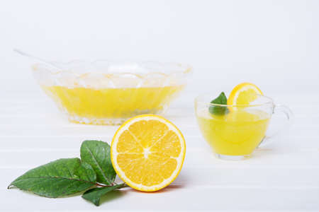 Lemon punch with pieces of fruit sweet alcohol summer drink
