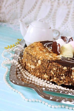 shredded coconut: Holiday meal concept. Sweet chocolate cake with peanuts, shredded coconut flakes and tea.