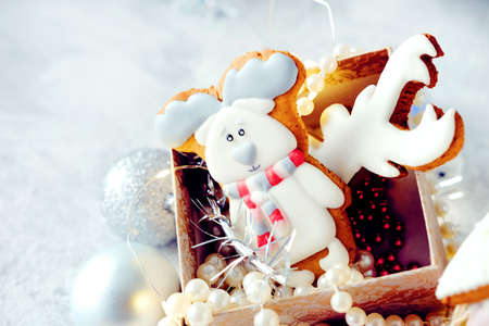 Magical winter christmas picture. Gingerbread cookies and  new year toys and decorations in paper box.