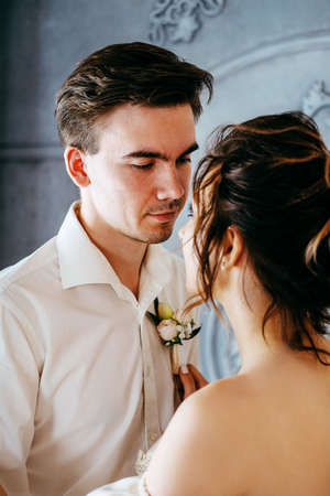 Two young lovers getting ready for the wedding kissing and embracing Stok Fotoğraf