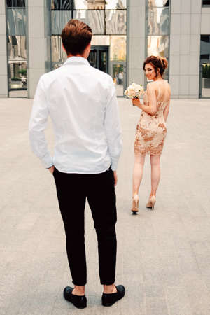 Young couple dressed for the occasion going together to the party