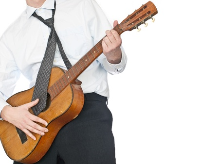 businessman playing an acoustic guitar