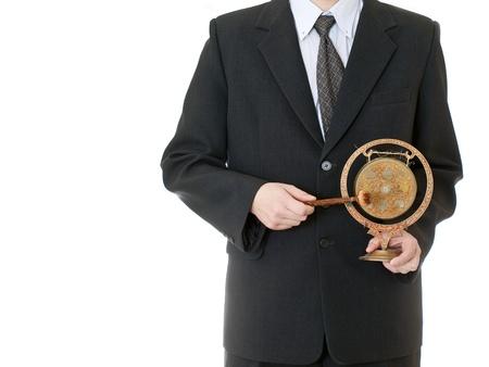 resonating: businessman holding gong on white background
