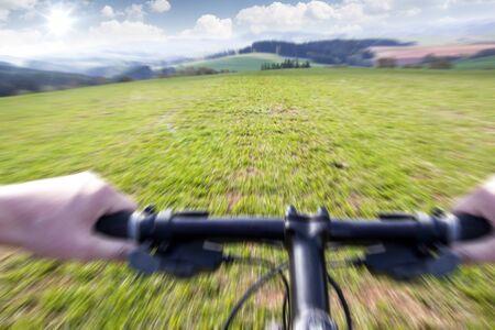 Mountain biking down the trail, motion blur photo