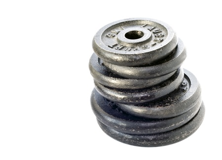dumbbell weights stacked and isolated on white