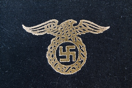 adolf: nazi eagle badge on book