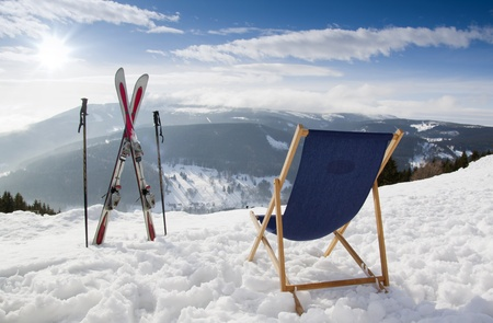 Cross ski and Empty sun-lounger at mountains in winter, Czech mountain