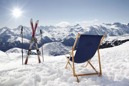 Cross ski and Empty sun-lounger at mountains in winter, France High mountain Stock Photo
