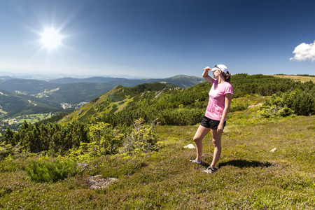Girl looks out over the mountains, Czech mountains Krkonose