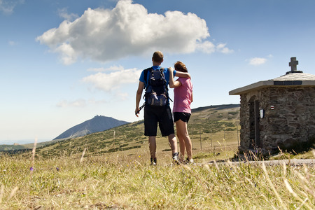Women and man looks out over the mountains, Czech mountains Krkonose photo