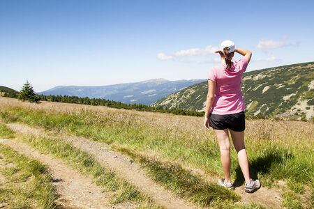 Girl looks out over the mountains, Czech mountains Krkonose photo