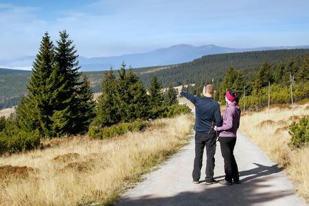 czech women: Women and man looks out over the mountains, Czech mountains Krkonose