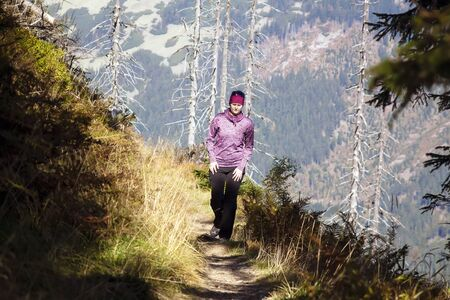 Girl with backpack walk over the mountains, Czech mountains Krkonose