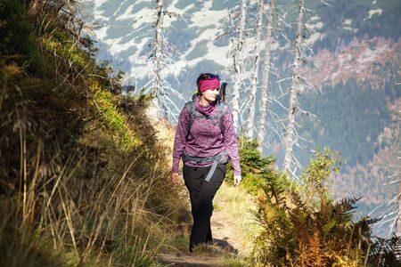 krkonose: Girl with backpack walk over the mountains, Czech mountains Krkonose