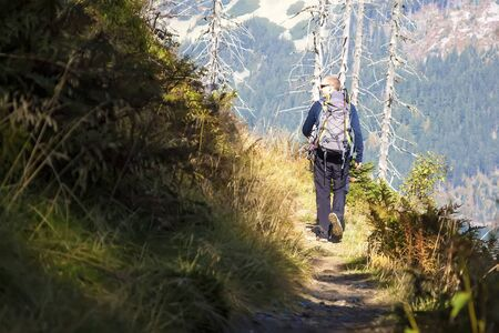 Man with backpack walk over the mountains, Czech mountains Krkonose
