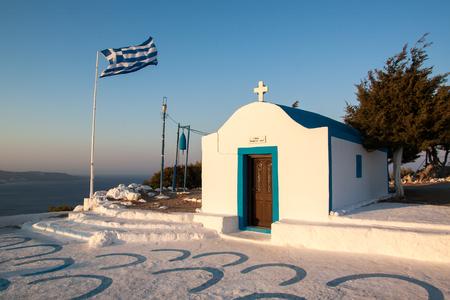 Greece white church with flag, Faliraki Rhodes Stock Photo