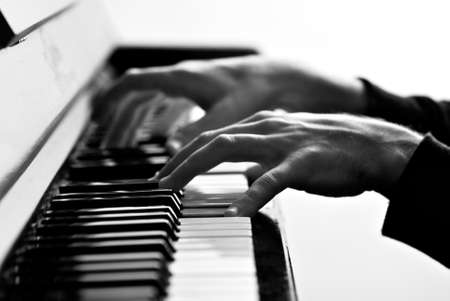 keyboard player: hands on a piano key