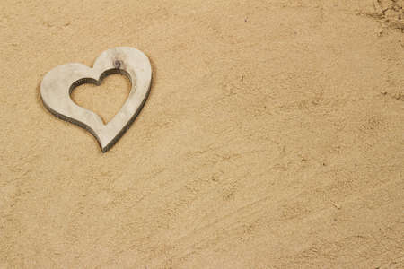 Handmade heart in the sand with copy space  photo