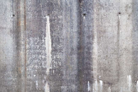 full of holes: Old grunge concrete wall background texture with drainage holes and moisture stains with discoloration, full frame view