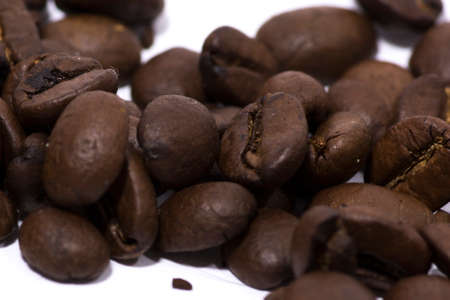 Roasted Mocha Coffee Beans close-up. Java coffee beans against a white background.