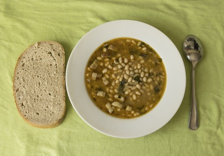 Plate with bean soup and bread