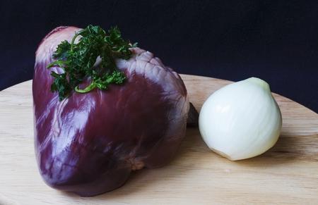 raw pork heart on board detail