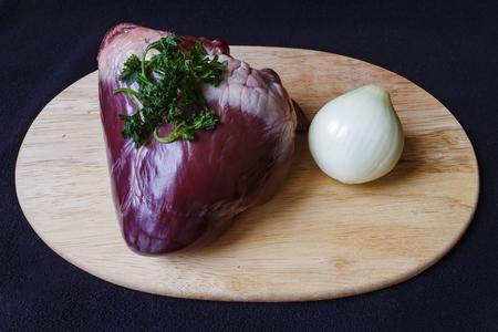 raw pork heart on board view Reklamní fotografie