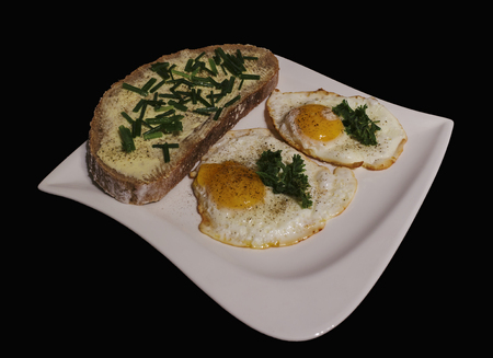 fried eggs with bread and butter on a white plate Reklamní fotografie - 49022841