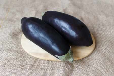 fresh eggplant on a cutting board