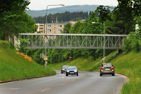 prefabricated buildings: Taken May 28, 2016 Jablonec nad Nisou Czech Republic footbridge over the main road in the background of nature and prefabricated buildings