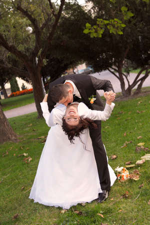 Bride and Groom in the park with the bridal bouquet photo