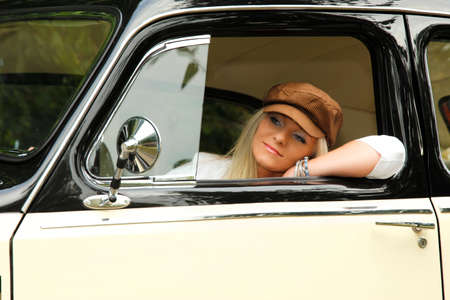 Young lady in the retro car