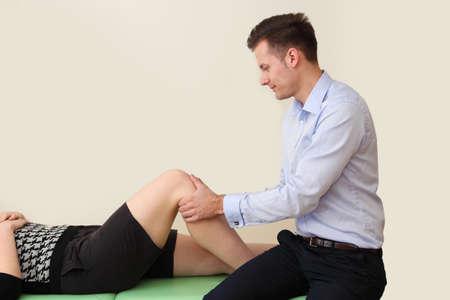 Young doctor rehabilitates his patient Banco de Imagens