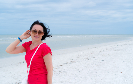 Portrait of a beautiful senior woman on the beach 写真素材