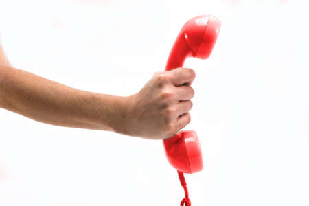 Red telephone receiver in hand photo