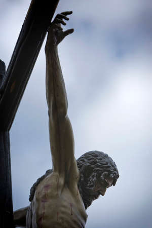 Figure of Jesus on the cross carved in wood by the sculptor Alvarez Duarte, Holy Christ of the Estudiantes, Linares, Jaen province, Spain photo