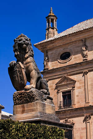 Lion statue with shield at Ubeda city, Jaen province, Andalusia, Spain