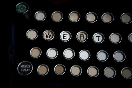 Worn keyboard of machine just write some letters are photo