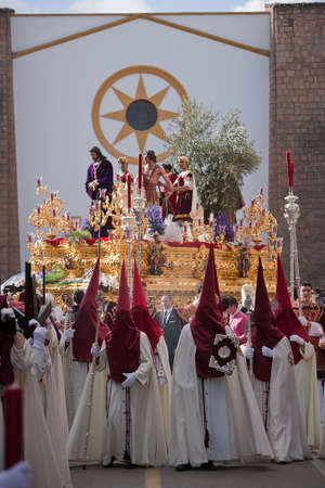 initiating: Brotherhood of Jesus in his apprehension by initiating its output in a procession of St. Augustines church, holy thursday, Linares Jaen province, Andalucia, Spain