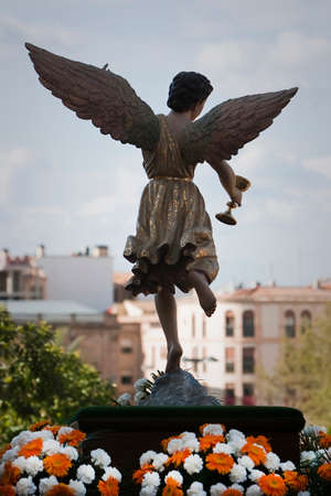 sacramental: Figure of an angel with wings sculpted in wood with the sacramental cup. Holy week, Spain