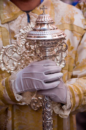 holy week: Dalmatic or white robe in a liturgical act of Holy Week, sceptre of silver, Spain