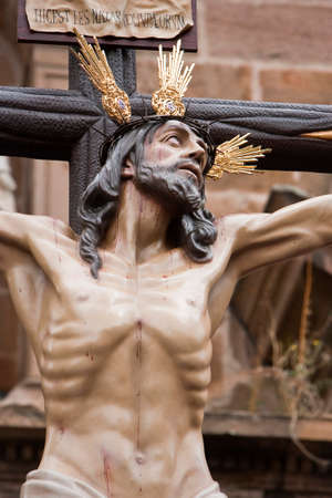 inri: Figure of Jesus on the cross carved in wood by the sculptor Gabino Amaya Guerrero, Holy Christ of the expiry, Linares, Jaen province, Spain