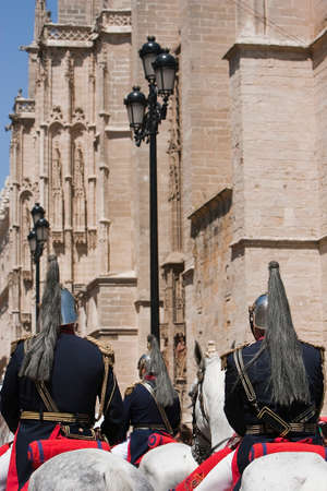 christianity palm sunday: Squadron mounted on horseback of Trumpets and kettledrums of the Brotherhood of La Paz passing by the Cathedral of Sevilla, Andalusia, Spain