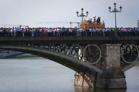 brotherhood:  Brotherhood of San Gonzalo passing the holy Monday by the Puente de Triana, Seville, Spain