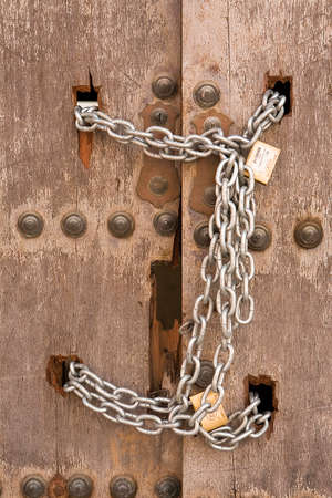 Door closed with chains, Osuna, Sevilla province, Spain photo