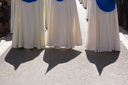 holy week: Shadows of penitents on Holy week procession, Spain