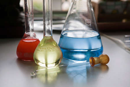 scientifical: chemical laboratory flasks containing liquid shiny